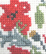 detail of Poppies cross stitch kit