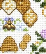 detail of Beehive with bee charm cross stitch kit