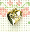 scroll heart brass charm