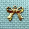 bow brass charm
