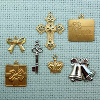 set of Celebration brass charms