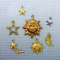 set of Celestial brass charms