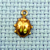 ladybird brass charm