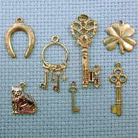 set of lucky brass charms