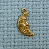 man in moon brass charm