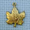 maple leaf brass charm