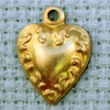 ornate heart brass charm