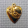 scroll-heart brass charm