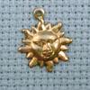 small sun brass charm