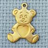 teddy brass charm
