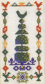 Topiary bird with ladybird charm cross stitch