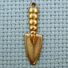 trowel brass charm
