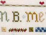 detail of alphabet sampler