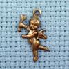 cherub brass charm