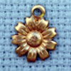 flower brass charm