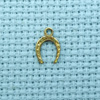 tiny horseshoe brass-charm