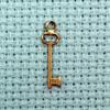 tiny key brass charm
