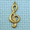 treble clef brass charm