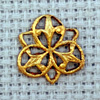 trefoil motif brass charm